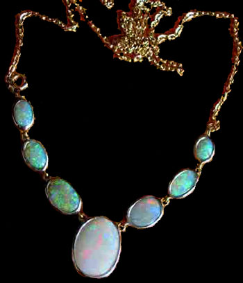 necklace and opals,necklace opals,opal necklace,jeweler with opal gemstone