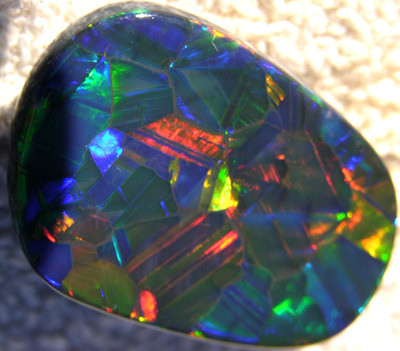 information on opals,looking for gemstone opal,a gemstone multicolor opal,australian opal,fire black opal