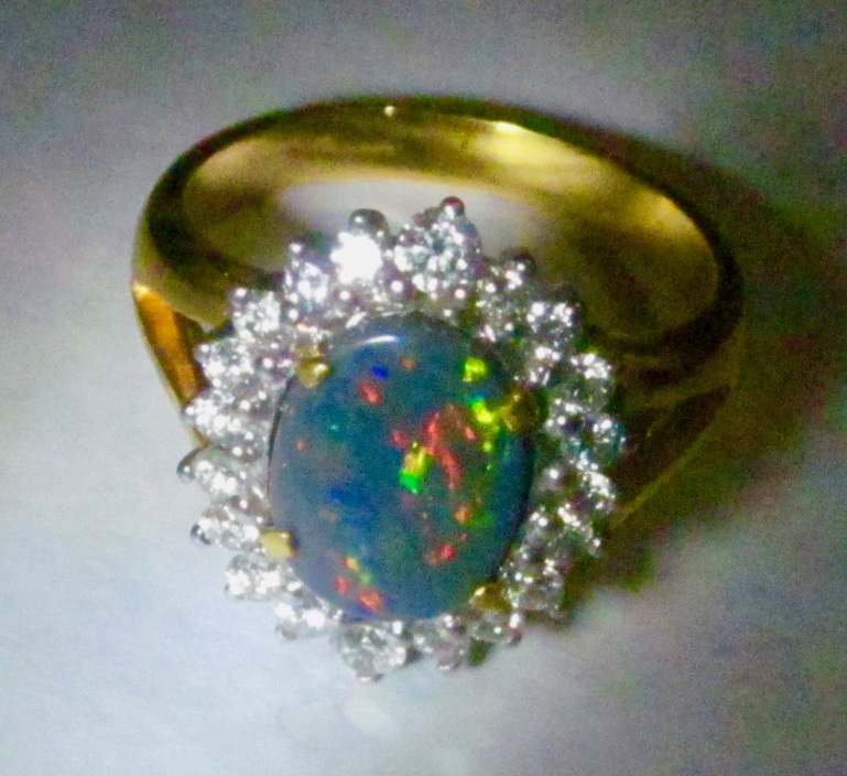 ring with opal gemstone multi- colours mixed.