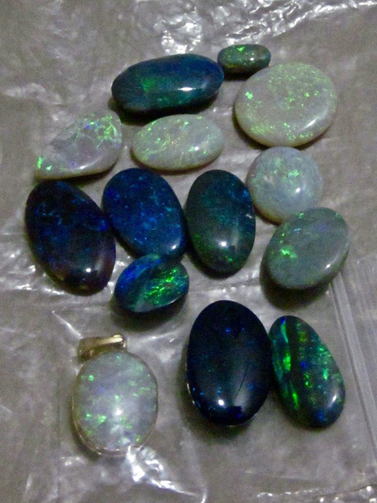 Parcel of Australian opal gemstones.