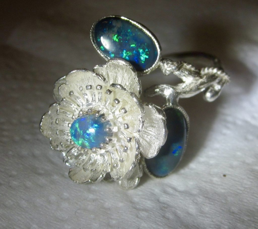 opal ring with 3 opal gemstones.