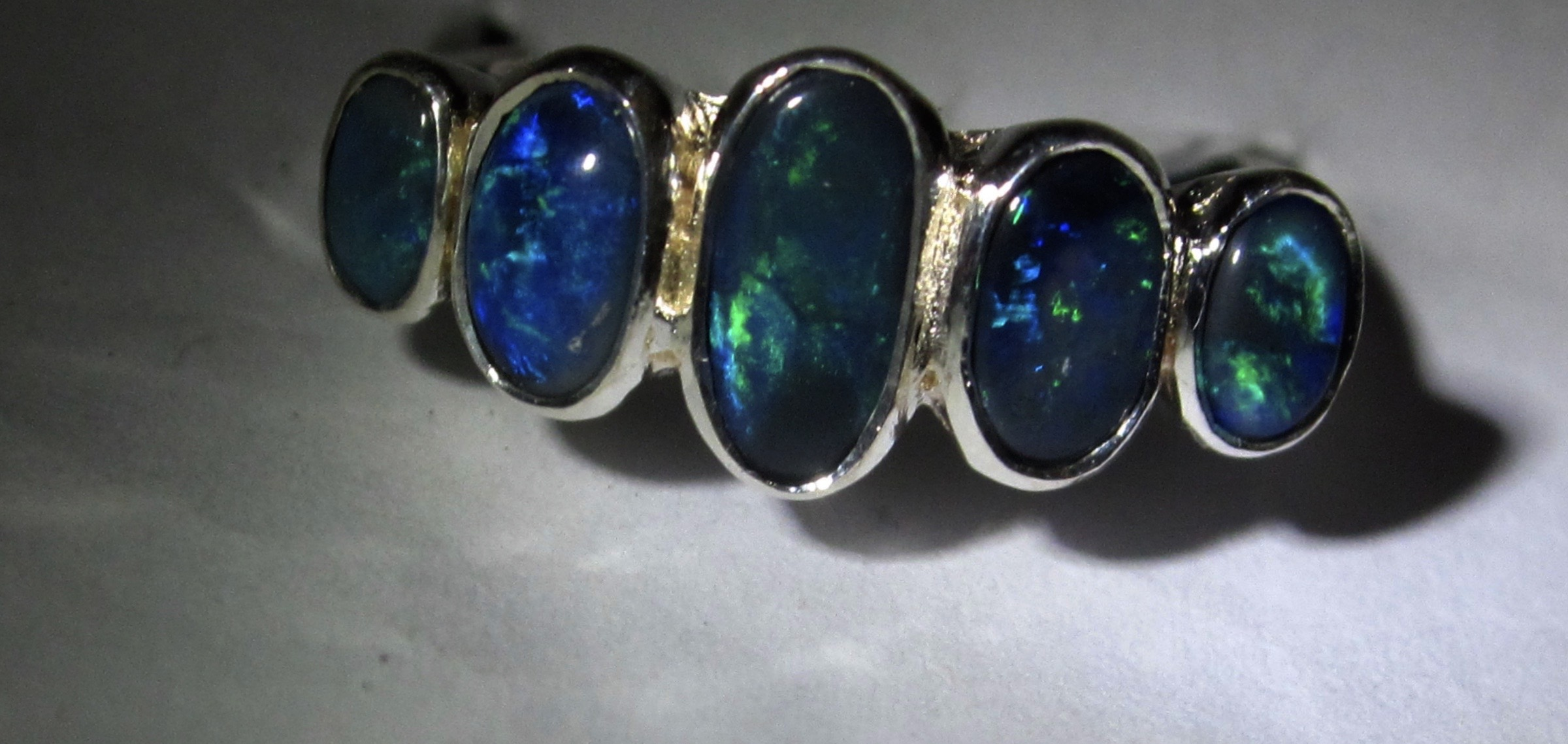 About Opals Gemstones .