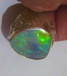 Green colour opal ring.